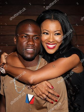 Kevin Hart and Denyce Lawton pose at Girlfriend Confidential LA Premiere Episode Party at Xen Lounge, in Studio City, California