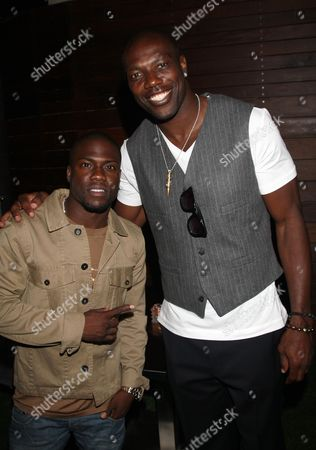 Kevin Hart and Terrell Owens pose at Girlfriend Confidential LA Premiere Episode Party at Xen Lounge, in Studio City, California