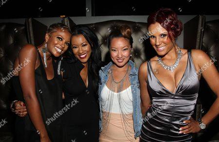 Cast members (L-R) Eva Marcille, Denyce Lawton, Kelly Marie Dunn and Nikki Chu attend Girlfriend Confidential LA Premiere Episode Party at Xen Lounge, in Studio City, California