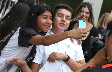 "Anthony Quintal, right, takes a selfie with a fan at GRB Entertainment's ""Bad Night"" premiere, in Los Angeles"