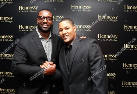 Stock Image of NFL player Chris Canty and New York Mets pitcher Jeurys Familia are seen at Hennessy V.S.O.P Privilege Celebrates Hennessy All-Star Jeurys Familia at Stage 48, in New York