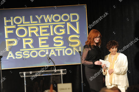 Stock Picture of Christina Hendricks and Aida Takla-O Reilly speak at the Hollywood Foreign Press Association luncheon at the Beverly Hills Hotel, in Beverly Hills, Calif