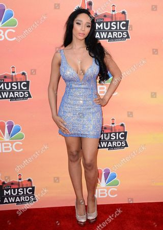 Stock Picture of Darnaa arrives at the iHeartRadio Music Awards at the Shrine Auditorium, in Los Angeles
