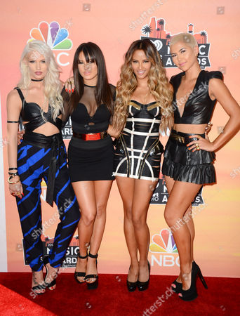 Lauren Bennett and from left, Natasha Slayton, Emmalyn Estrada and Paula Van Oppen, of the musical group G.R.L., arrive at the iHeartRadio Music Awards at the Shrine Auditorium, in Los Angeles