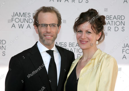 Restauranteur Dan Barber, left, and his wife Aria Beth Sloss, right, arrive at the James Beard Foundation Awards Gala on in New York