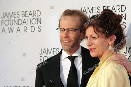 Stock Image of Restauranteur Dan Barber, left, and his wife Aria Beth Sloss, right, arrive at the James Beard Foundation Awards Gala on in New York