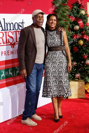 "Danny Glover, left, and Eliane Cavalleiro arrive at the LA Premiere of ""Almost Christmas"" at the Regency Village Theatre, in Los Angeles"