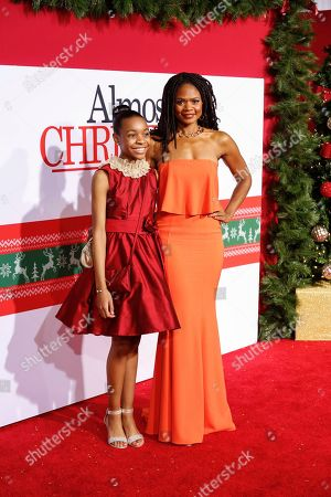 """Nadej Bailey, left, and Kimberly Elise arrive at the LA Premiere of """"Almost Christmas"""" at the Regency Village Theatre, in Los Angeles"""