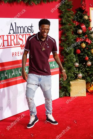 "DC Young Fly arrives at the LA Premiere of ""Almost Christmas"" at the Regency Village Theatre, in Los Angeles"