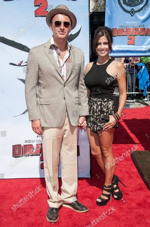 """Julian McMahon, left, and Kelly Paniagua arrive at the LA Premiere of """"How To Train Your Dragon 2"""" held at the Regency Village Theater on in Los Angeles"""