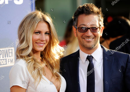 """Luke Greenfield, director of """"Let's Be Cops,"""" poses with his wife Sarah Baldwin at the premiere of the film on in Los Angeles"""