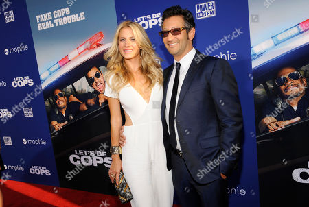 """Luke Greenfield, director of """"Let's Be Cops,"""" and his wife Sarah Baldwin pose together at the premiere of the film on in Los Angeles"""