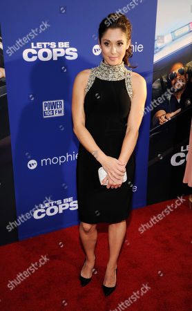 "Stock Photo of Jessica Luza, a cast member in ""Let's Be Cops,"" poses at the premiere of the film on in Los Angeles"