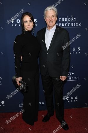 "Verena King, left, and Bruce Boxleitner arrive at the LA Premiere Of ""The Theory Of Everything"", in Beverly Hills, Calif"