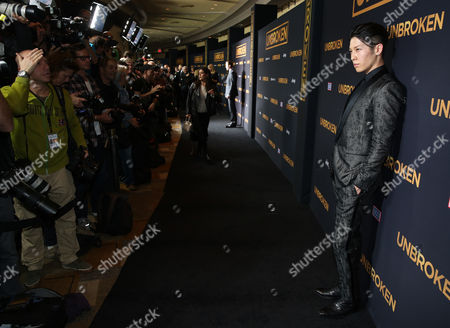"Takamasa Ishihara arrives at the Los Angeles premiere of ""Unbroken"" at TCL Chinese Theatre on"
