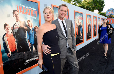 """Christina Applegate, left, a cast member in """"Vacation,"""" poses with her husband Martyn LeNoble at the premiere of the film, in Los Angeles"""