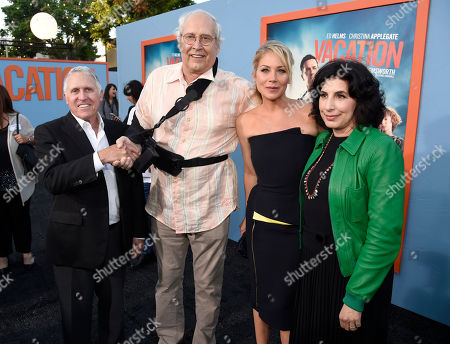 "Dan Fellman, president, domestic distribution, Warner Bros. Pictures, from left, Chevy Chase, Christina Applegate and Sue Kroll, president, worldwide marketing and international distribution, Warner Bros. Pictures, arrive at the Los Angeles premiere of ""Vacation"" at the Regency Village Theatre on"