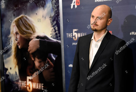 """J Blakeson, director of """"The 5th Wave,"""" poses at a special screening of the film, in Los Angeles"""