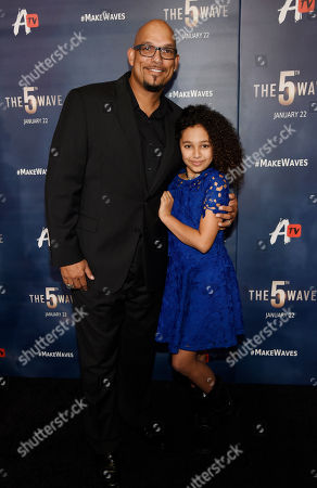 """Stock Photo of Former Major League Baseball player David Justice, left, and his daughter Raquel pose together at a special screening of the film """"The 5th Wave"""", in Los Angeles"""