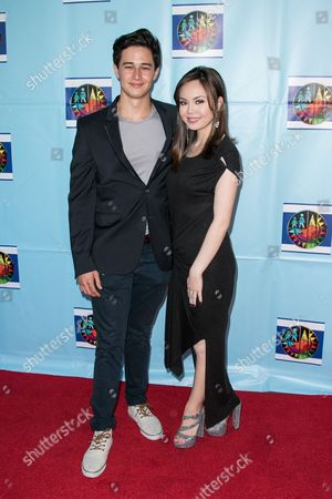 Stock Image of Ivan Dorschner, left, and Anna Perez De Tagle arrive at the Let's Celebrate! District Wide Arts Festival held at The Academy of Motion Pictures Arts & Sciences on in Beverly Hills, Calif