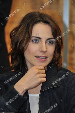Antje Traue of 'Seventh Son' signs autographs for fans at the Legendary Entertainment booth at Comic-Con International 2013, on Saturday, July, 20, 2013 in San Diego