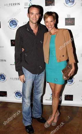 Actress Ashley Scott (R) and bother attend Marcus Allen Foundation 2013 Celebrity Invitational Poker Tournament on Sunday, June 2nd, 2013 at Lucky Strike Hollywood in Los Angeles, California