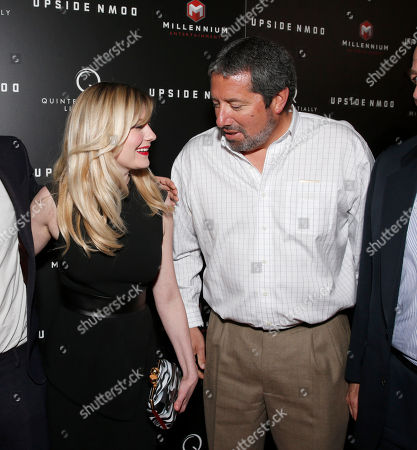 Kirsten Dunst and Millennium Entertainment President Steve Nickerson attend Millennium Entertainment's Upside Down Los Angeles Premiere hosted by Quintessentially at Arclight Hollywood on in Los Angeles