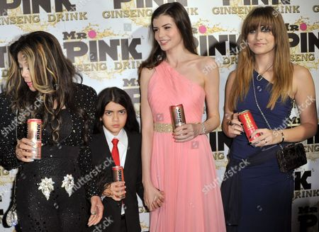 From left, LaToya Jackson, Blanket Jackson, Monica Gabor and Paris Jackson attend the Mr. Pink Ginseng launch party at the Beverly Wilshire hotel, in Beverly Hills, Calif