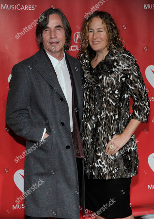Jackson Browne, left, and Dianna Cohen arrive at the MusiCares Person of the Year tribute honoring Bruce Springsteen at the Los Angeles Convention Center, in Los Angeles