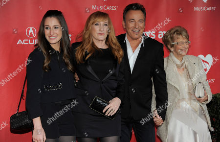 From left, Jessica Rae Springsteen, Patti Scialfa, Honoree Bruce Springsteen, and Adele Springsteen arrive at the MusiCares Person of the Year tribute honoring Bruce Springsteen at the Los Angeles Convention Center, in Los Angeles