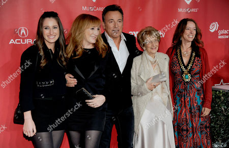 From left, Jessica Rae Springsteen, Patti Scialfa, Honoree Bruce Springsteen, Adele Ann Springsteen and Pamela Springsteen arrive at the MusiCares Person of the Year tribute honoring Bruce Springsteen at the Los Angeles Convention Center, in Los Angeles