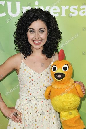 Carly Ciarrocchi, left, and Chica arrive at the NBC Universal Summer Press Day, in Pasadena, Calif