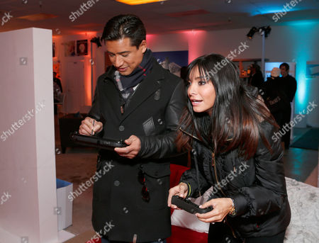 Mario Lopez, left, and Courtney Laine Mazza warm up and check out Wii U at the Nintendo Lounge while playing New Super Mario Bros. U during a break from the Sundance Film Festival on in Park City, UT