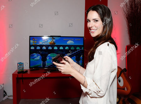 Actress Katie Savoy warms up and checks out Wii U at the Nintendo Lounge while playing New Super Mario Bros. U during a break from the Sundance Film Festival on in Park City, UT