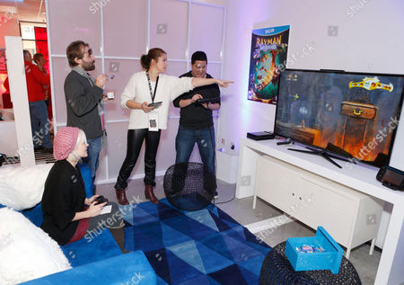 Stock Image of Brea Grant, left, warms up and checks out Wii U at the Nintendo Lounge while playing Rayman Legends during a break from the Sundance Film Festival on in Park City, UT