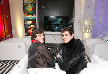 Actors Alex Shaffer, left, and David Lambert warm up and check out Wii U at the Nintendo Lounge while playing ZombiU from Ubisoft during a break from the Sundance Film Festival on in Park City, UT