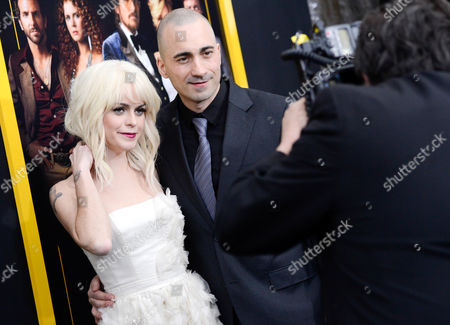 """Actress Taryn Manning, left, and boyfriend actor Jay Giannone attend the premiere of """"American Hustle"""" at the Ziegfeld Theatre on in New York"""