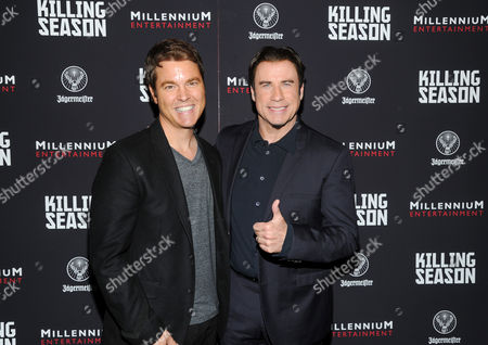 """Stock Image of Director Mark Steven Johnson, left, and actor John Travolta attend a special screening of """"Killing Season"""" hosted by Jagermeister at the Sunshine Landmark Theater on in New York"""
