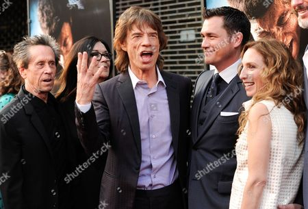 "Producers, from left, Brian Grazer, Victoria Pearman, Mick Jagger, Tate Taylor, and Erica Huggins attend the world premiere of ""Get On Up"" at the Apollo Theater, in New York"