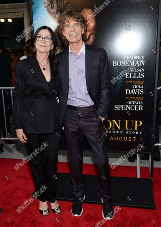"Producers Victoria Pearman and Mick Jagger attend the world premiere of ""Get On Up"" at the Apollo Theater, in New York"