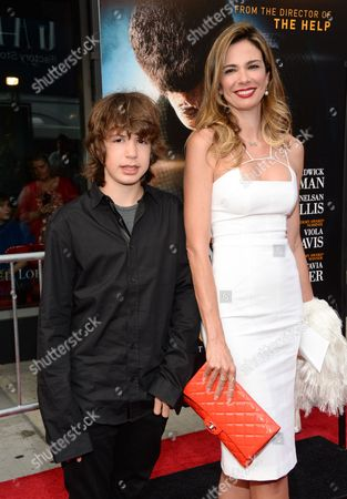 """Stock Image of Mick Jagger's ex-girlfriend Luciana Gimenez and their son Lucas Maurice Morad-Jagger attend the world premiere of """"Get On Up"""" at the Apollo Theater, in New York"""