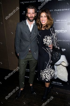 "Jennifer Esposito and Louis Dowler attends a screening of FilmDistrict's ""Olympus Has Fallen"" hosted by the Cinema Society with Roger Dubuis and Grey Goose on in New York"