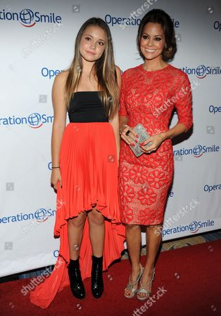 Brooke Burke-Charvet, right, and Neriah Fisher arrive at Operation Smile's 2013 Smile Gala at The Beverly Wilshire Hotel on in Beverly Hills, Calif