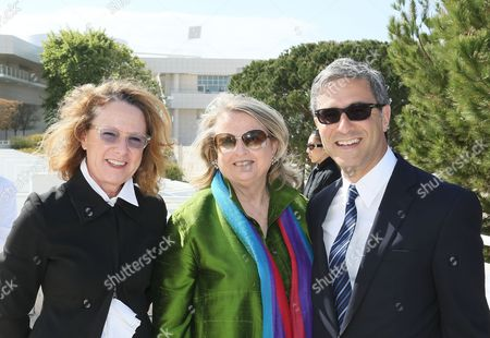 From left, Ann Philbin, Director, Hammer Museum; Aileen Adams, Los Angeles Deputy Mayor and Michael Govan, CEO Los Angeles County Museum of Art and Wallis Annenberg Director pose during a press conference for Pacific Standard Time Presents: Modern Architecture in L.A. launch and press preview for Overdrive: L.A. Constructs the Future, 1940-1990 and In Focus: Ed Ruscha held at the Getty Center on in Los Angeles, California