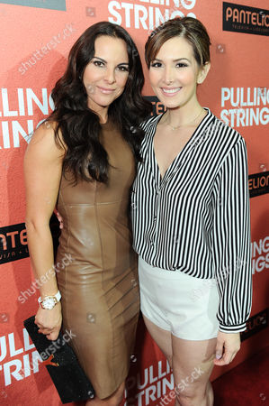 """Kate del Castillo, left, and Aurora Papile arrive at Pantelion Films' """"Pulling Strings"""" Los Angeles premiere at Regal Cinemas L.A. Live on in Los Angeles"""