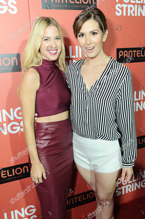 "Aurora Papile, left, and Laura Ramsey arrive at Pantelion Films' ""Pulling Strings"" Los Angeles premiere at Regal Cinemas L.A. Live on in Los Angeles"