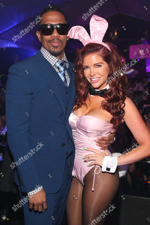 Stock Photo of Nick Cannon and Playboy Playmate Kayla Collins pose at the Playboy Super Bowl XLIX Party on in Scottsdale, Ariz