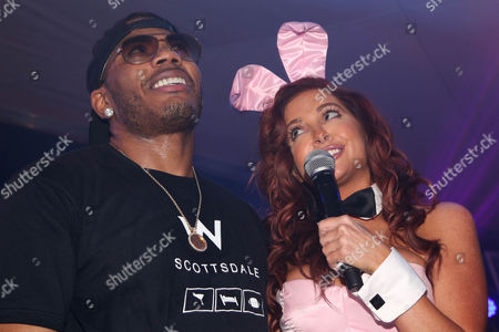 Nelly and Playboy Playmate Kayla Collins sing together during the Playboy Super Bowl XLIX Party on in Scottsdale, Ariz