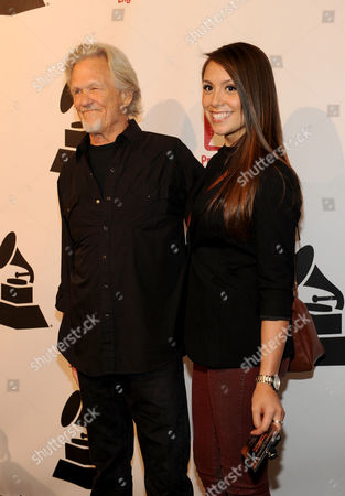 Stock Photo of From left, Kris Kristofferson and Samantha Schultz arrive at the Producers and Engineers of The Academy's 7th Annual Grammy Week Event, at The Village Recording Studios, on in West Los Angeles, Calif