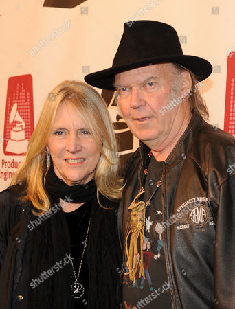From left, Pegi Young and Neil Young arrive at the Producers and Engineers of The Academy's 7th Annual Grammy Week Event, at The Village Recording Studios, on in West Los Angeles, Calif